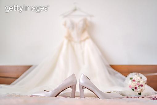 Wedding high heels on white bed sheet