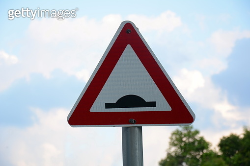 Speed bump sign. Triangle traffic sign warning there is a threshold coming up in the road.