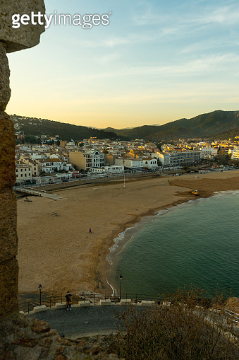 Beach at Tossa de Mar and fortress in a beautiful summer day