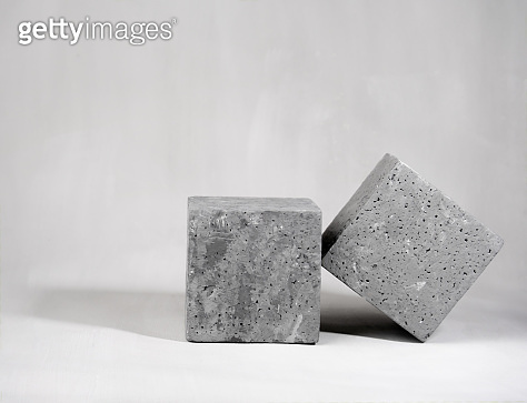 Concrete empty podiums on a gray background.