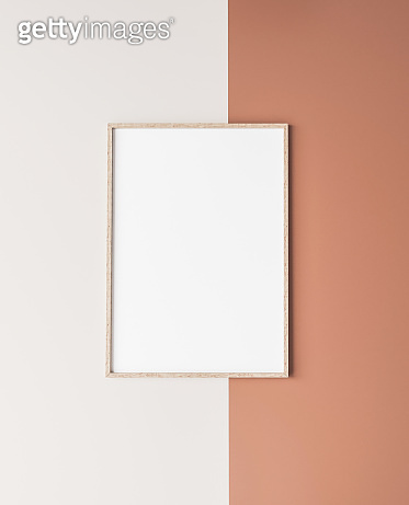 Wooden vertical frame mockup on orange and white wall