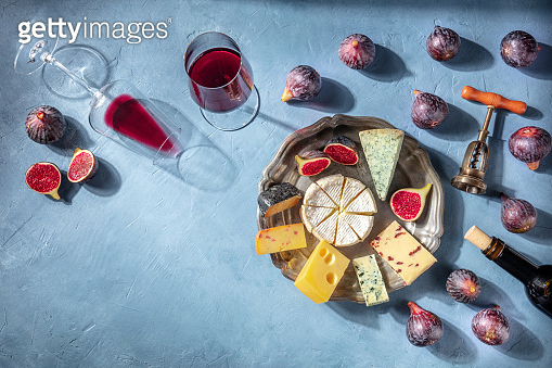 Wine and cheese tasting background with a place for text. Red wine, Brie etc