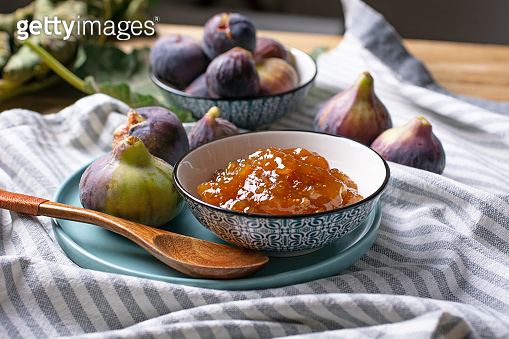 Homemade fig jam with fruits around - closeup