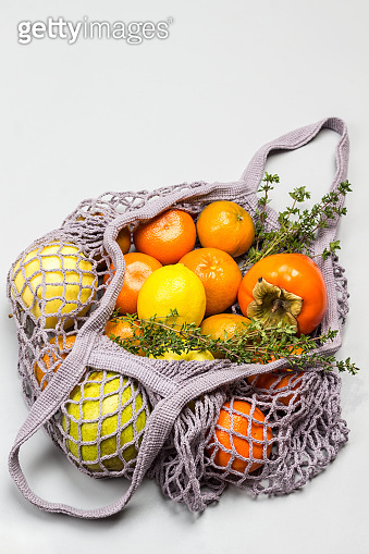 Reusable mesh bag with fruits.