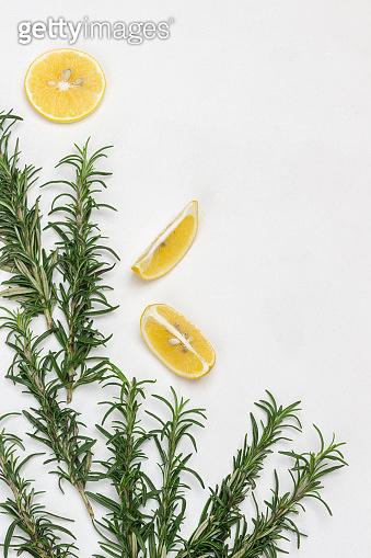 Sprigs of rosemary and lemon wedges.