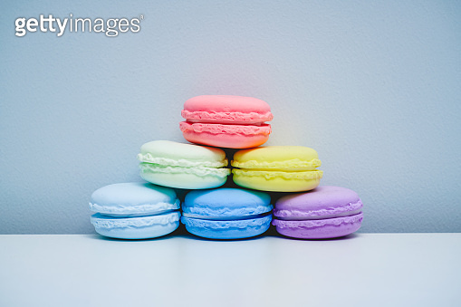 Bright and colorful French dessert macaron placed on a white table