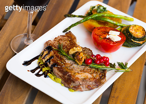 Photography of plate with baked veal with vegetables