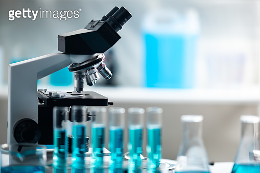 professional microscope in laboratory, science equipment and medical tools to looking micro scale, microbiology and medicine research in laboratory with microscope