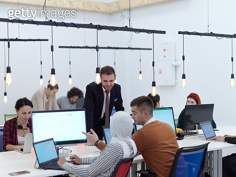 creative business people group as freelancers in modern coworking open space office