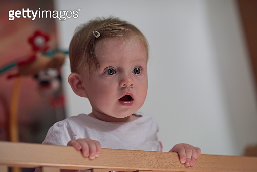 cute little one year old baby and making first steps in bed