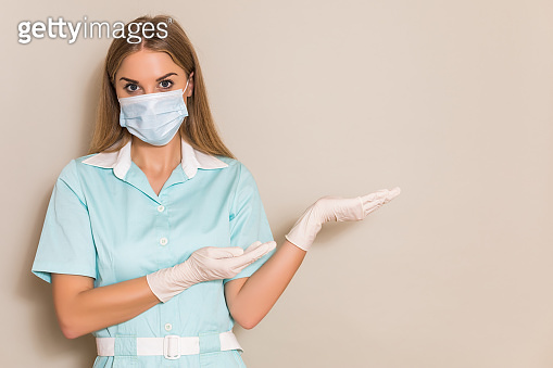 Nurse with protective mask gesturing