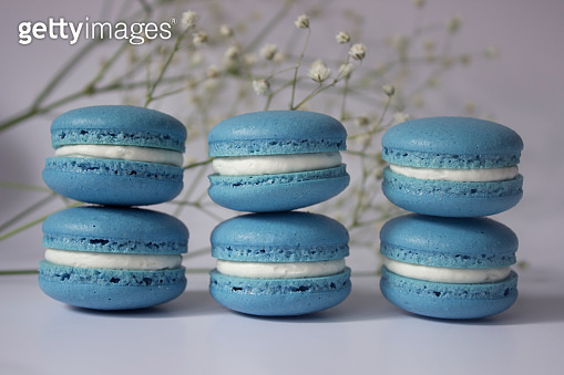 Macarons with flower in background