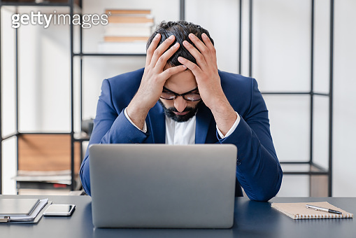 Overworked.Troubles with business, failure on audition, young businessman is fired. Solving difficult problem, stress on workplace and workaholism concept. Making mistake, having headache and migraine