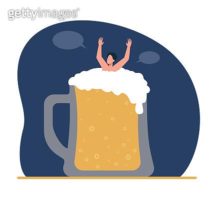 Guy bathing in glass of beer