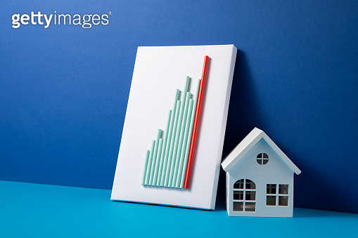 Mortgage Concept with Home and Bar Graph