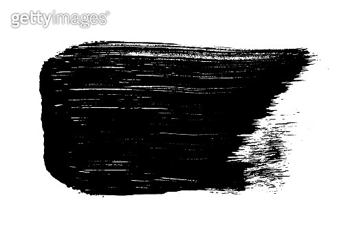 Black brush stroke isolated on white.