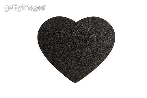 A blank black wooden heart with copy space