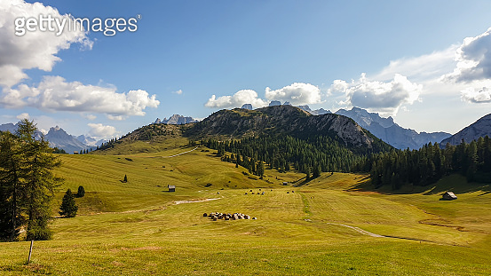 Strudelkopf - A panoramic view on the high Italian Dolomites from the top of Strudelkopf. There is a wide gravelled path