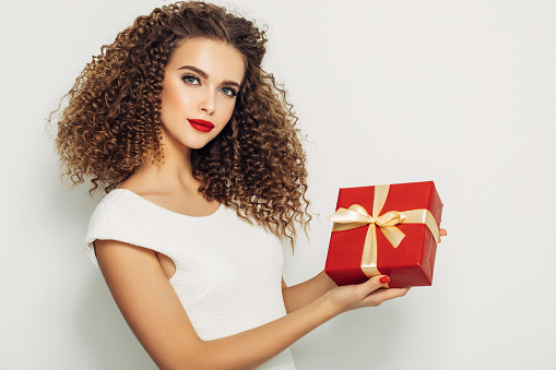 Beautiful woman with a Christmas gift