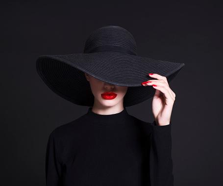 black hat woman