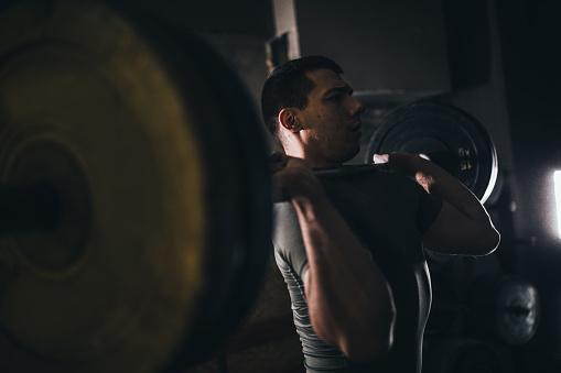 Man weightlifting in gym
