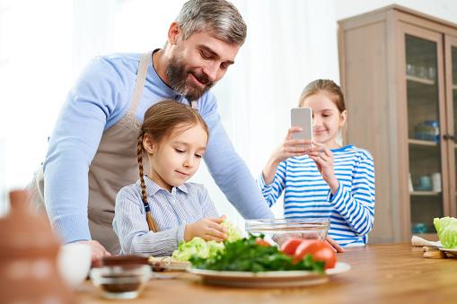 family making salad
