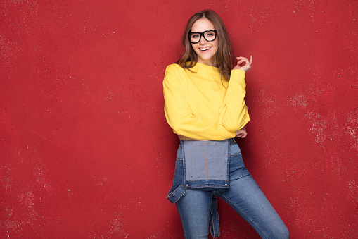 wearing yellow blouse, jeans