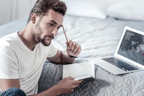 man & notebook