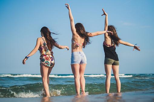 Carefree girls on the beach