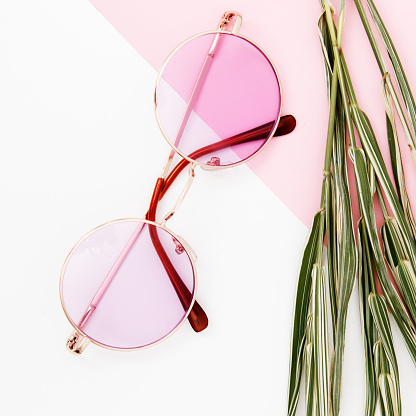 glasses on a pastel background