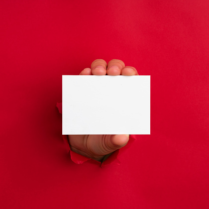 Human hand showing business card