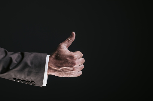Businessman hand pointing on black background