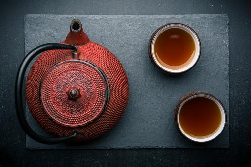 Tea, red iron teapot