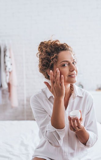 Woman Using Cosmetic
