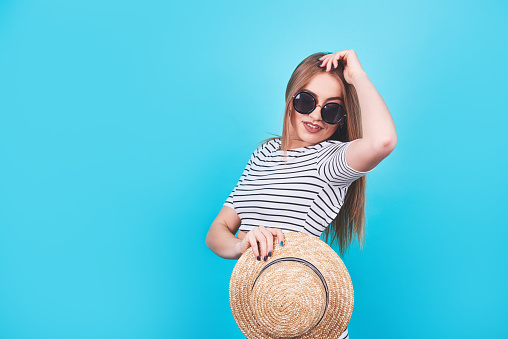 girl in a stripes, hat, sunglasses
