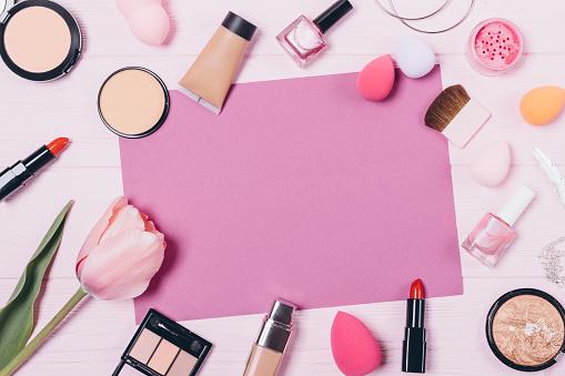 Festive flat layout of decorative cosmetics