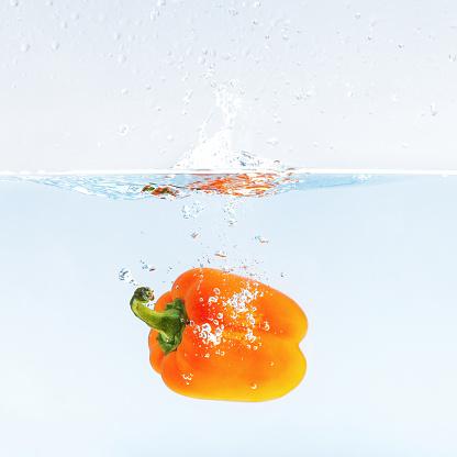 Paprika in water splashes