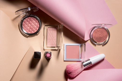 Cosmetics with paper background