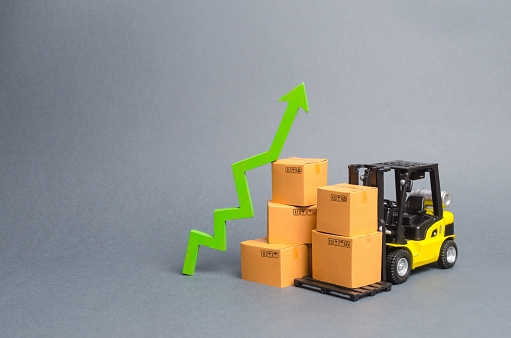 Yellow Forklift truck with boxes