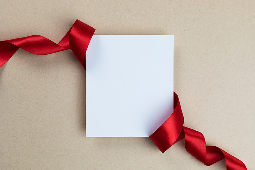 White blank card with ribbon