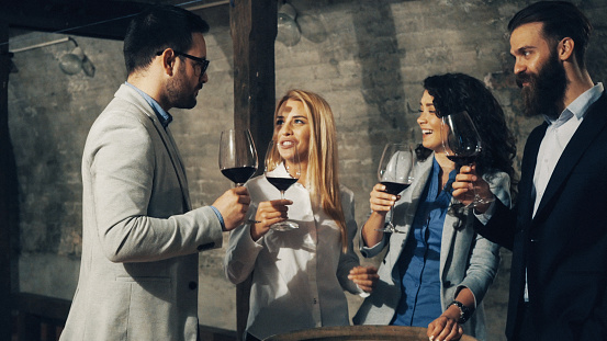 Friends tasting wine together
