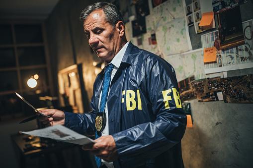 Detective examining evidences at night