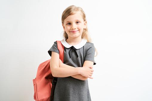 Little girl wearing school uniform