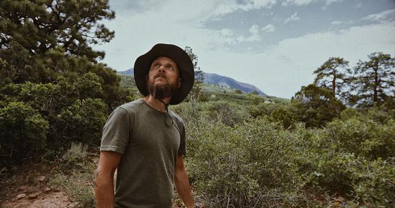 Explorer man hiking near Canyonlands