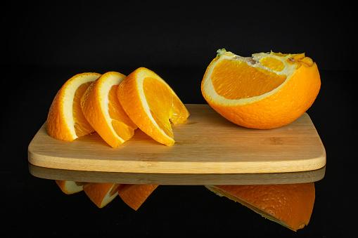 Orange on black glass