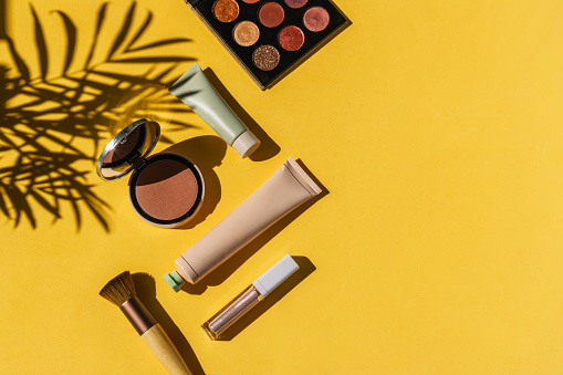 Cosmetic product on yellow background