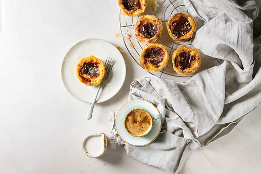 egg tart with cup of black coffee