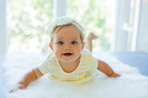 Happy baby girl looking up