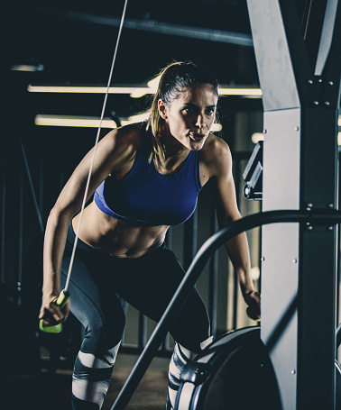 Woman doing Straight-arm pulldown exercise
