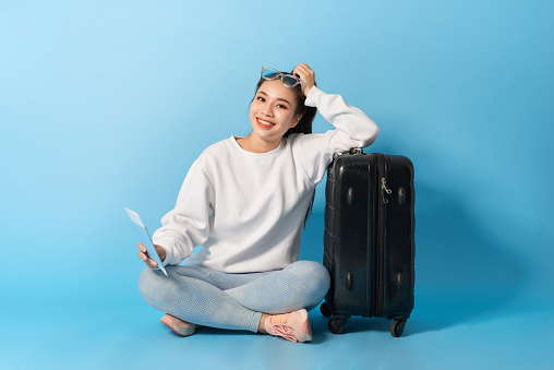 Asian female with suitcase